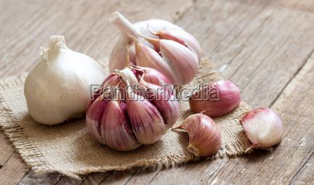 fresh garlic on wooden background