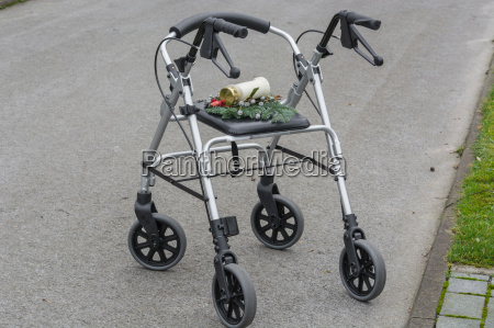 walker walking aid with grave candle
