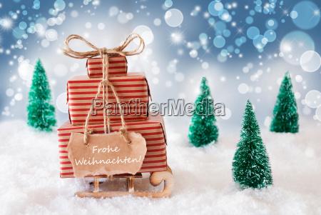 sleigh on blue background frohe weihnachten