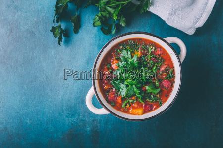 goulash soup with potatoes and salami