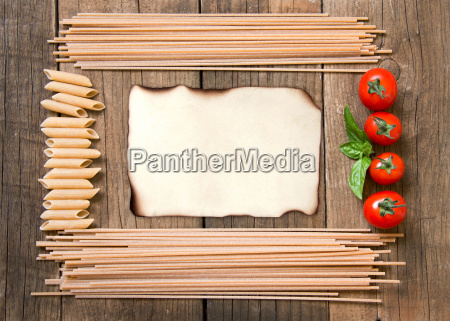 pasta tomatoes and basil on wooden
