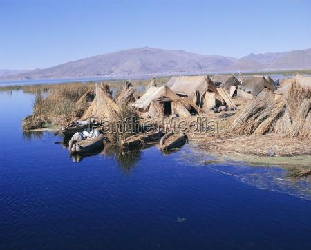 uros indian dwellings beside lake peru
