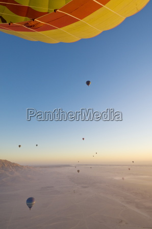 lots of hot air balloons flying