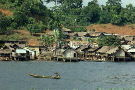 pirogue adjoukron fishing village on lagoon