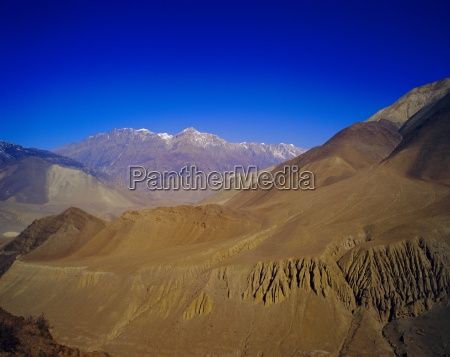 arid landscape and colourful mountains on