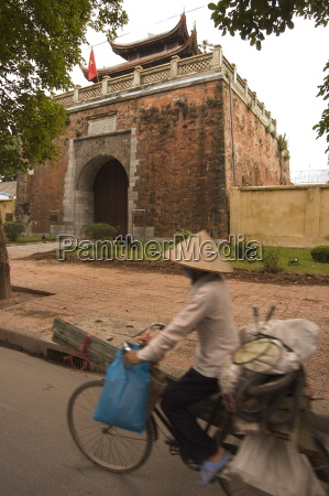 city wall gate lady wearing conical