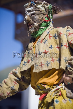 dancers in costume at tsechu festival