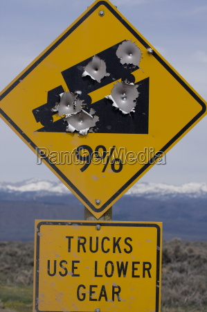 bullet holes in road sign pinedale