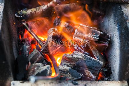 iron rod is heated in burning
