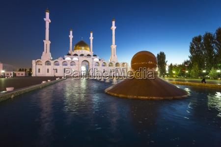 nur astana mosque at dusk astana