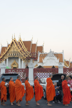 monks collecting morning alms the marble