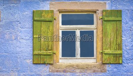 german window with shutters
