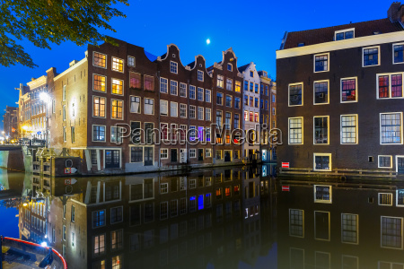 night typical dutch house amsterdam netherlands