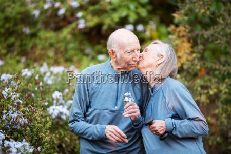 loving couple kissing in garden