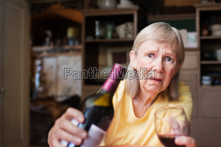 concerned female offering wine and glass