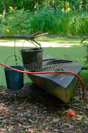 old canoe ashore the pond with