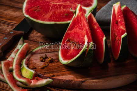 watermelon slices and peels lying on