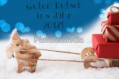 reindeer on blue background guten rutsch