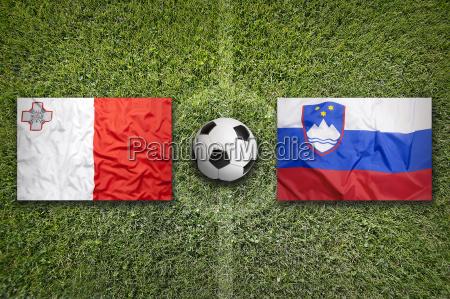 malta vs slovenia flags on soccer