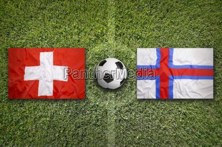 switzerland vs faroe islands flags on