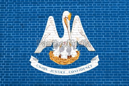 flag of louisiana on brick wall