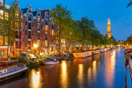 night amsterdam canal and westerkerk church