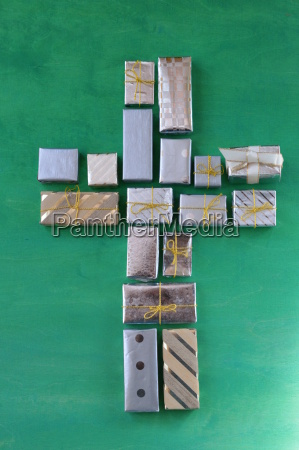 cross of many small gifts on