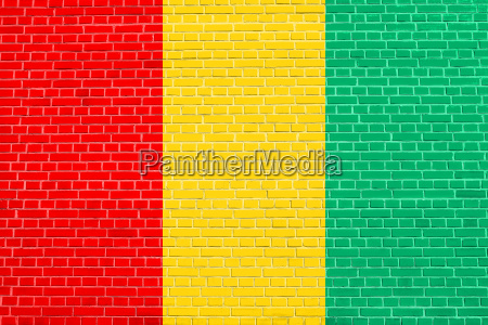 flag of guinea on brick wall