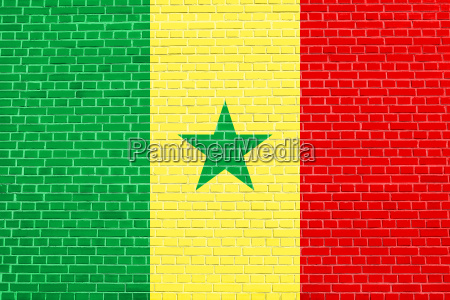 flag of senegal on brick wall