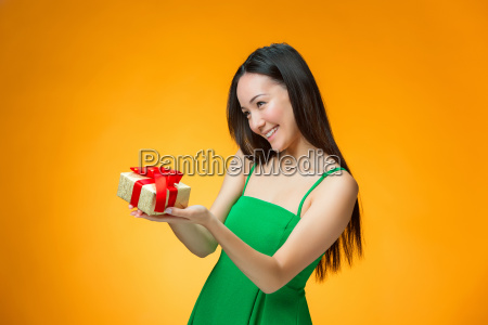 chinese, girl, with, a, gift - 19115647