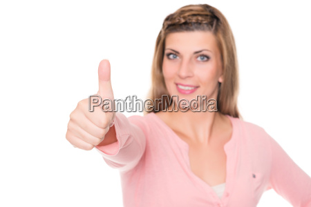 young woman is stretching thumbs up