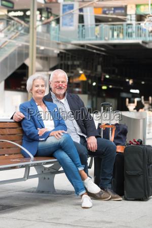 seniors at a train station