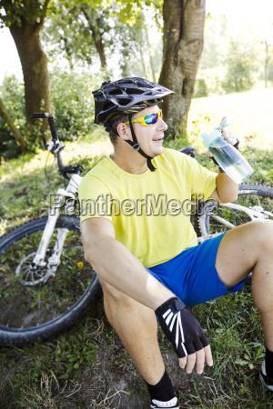 mountain, biker, takes, a, break - 19131571