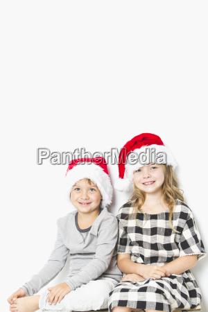 christmas kids in santa hat on
