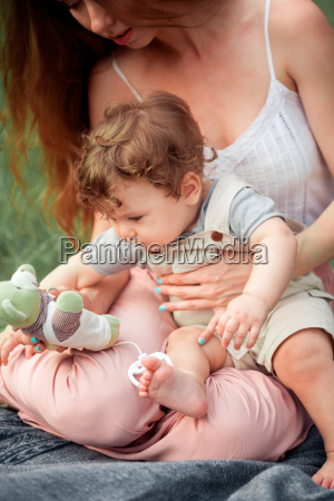 young, beautiful, mother, sitting, with, her - 19134459