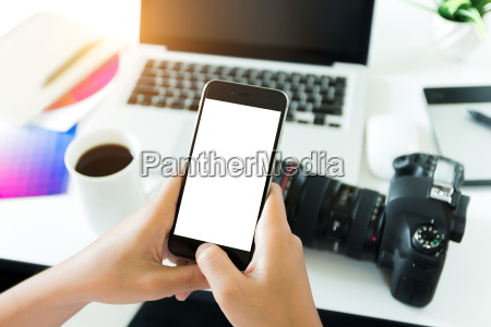 creative photogeapher holding phone white screen