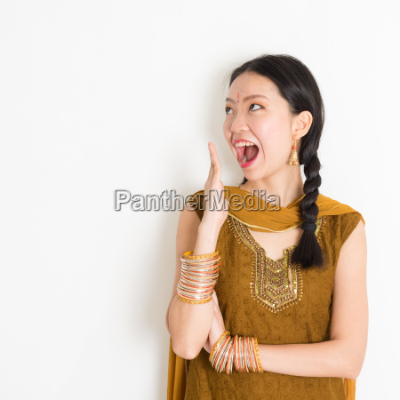 mixed race indian woman getting surprised
