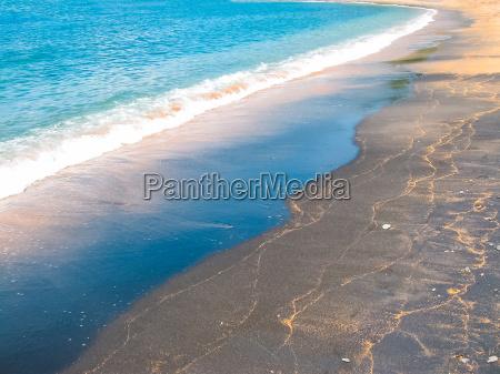 black sand beach at bali island
