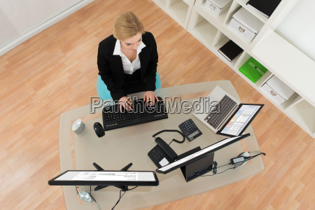 businesswoman on fitness ball while working