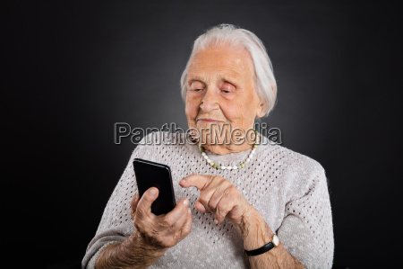 senior woman using smartphone