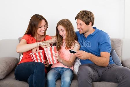 happy family eating popcorn