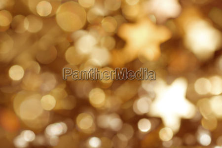 golden background with stars and bokeh