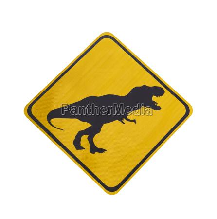 yellow traffic label with dinosaur pictogram