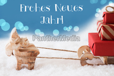 reindeer sled light blue background neues