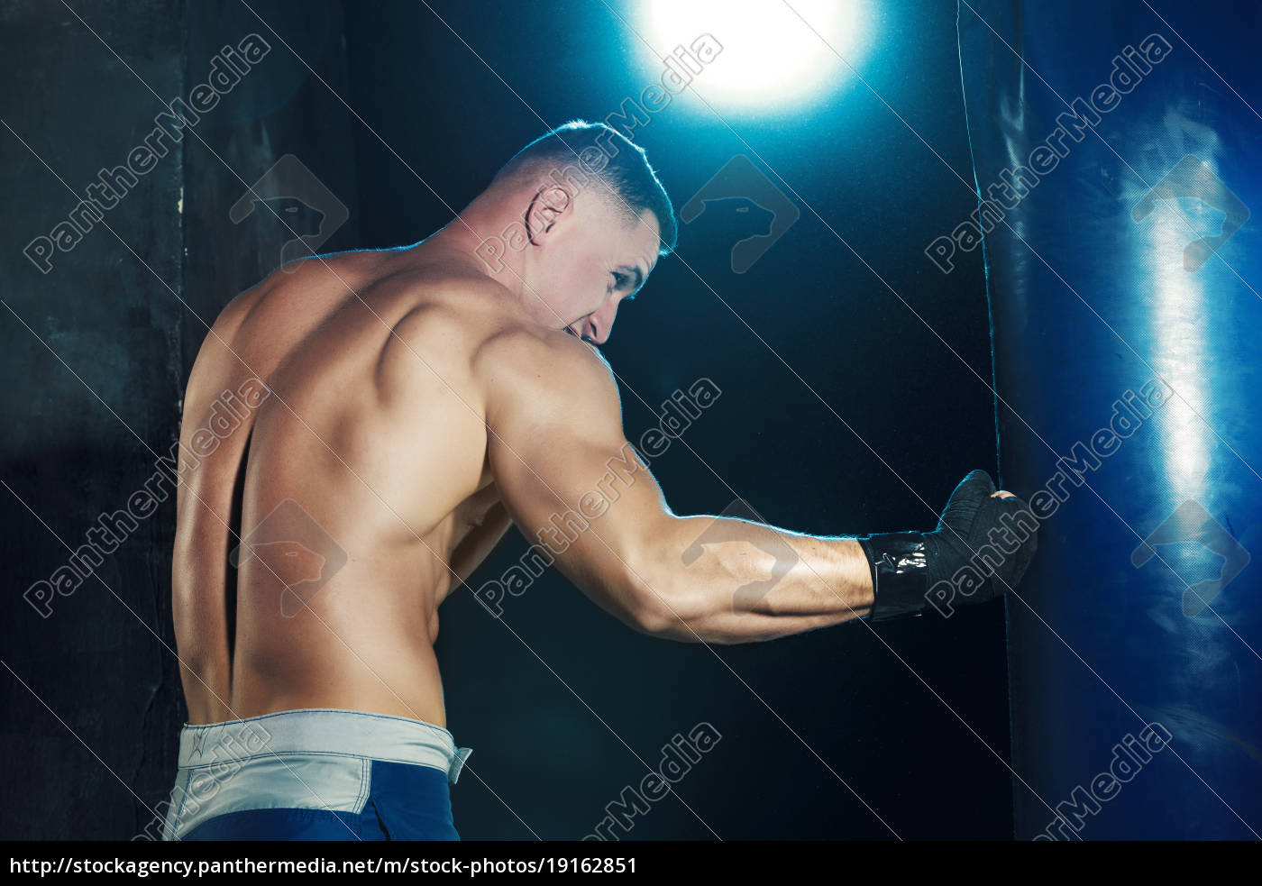 male, boxer, boxing, in, punching, bag - 19162851
