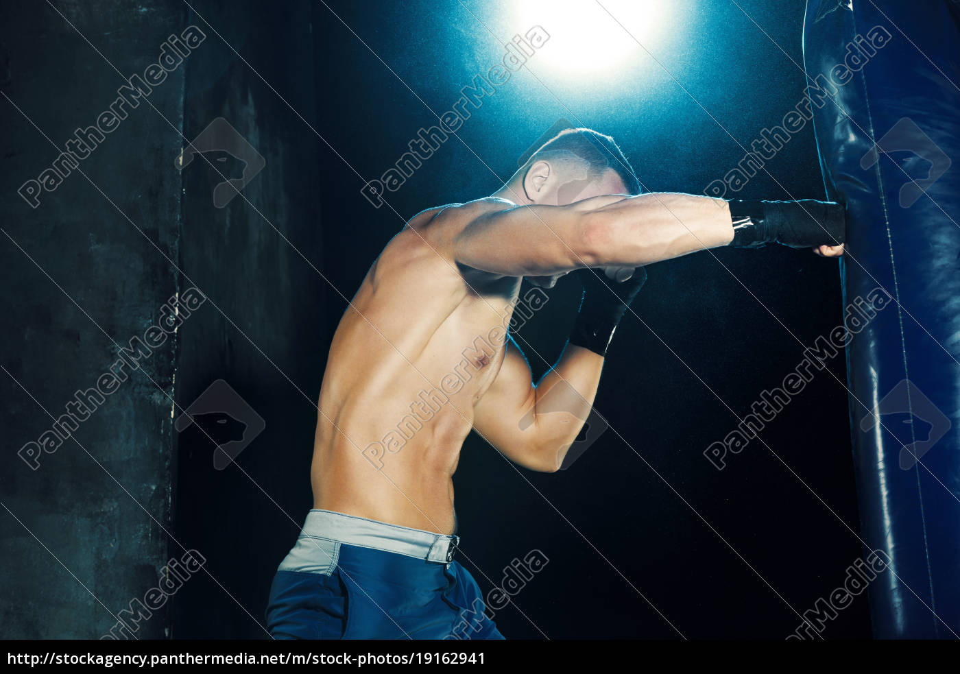 male, boxer, boxing, in, punching, bag - 19162941