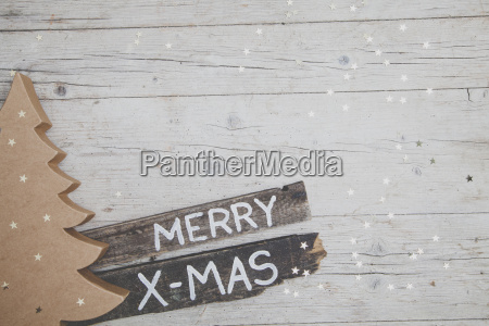 weihnachtlicher gray wooden background with decoration