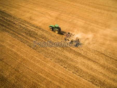 aerial, view, of, a, tractor, working - 19164919