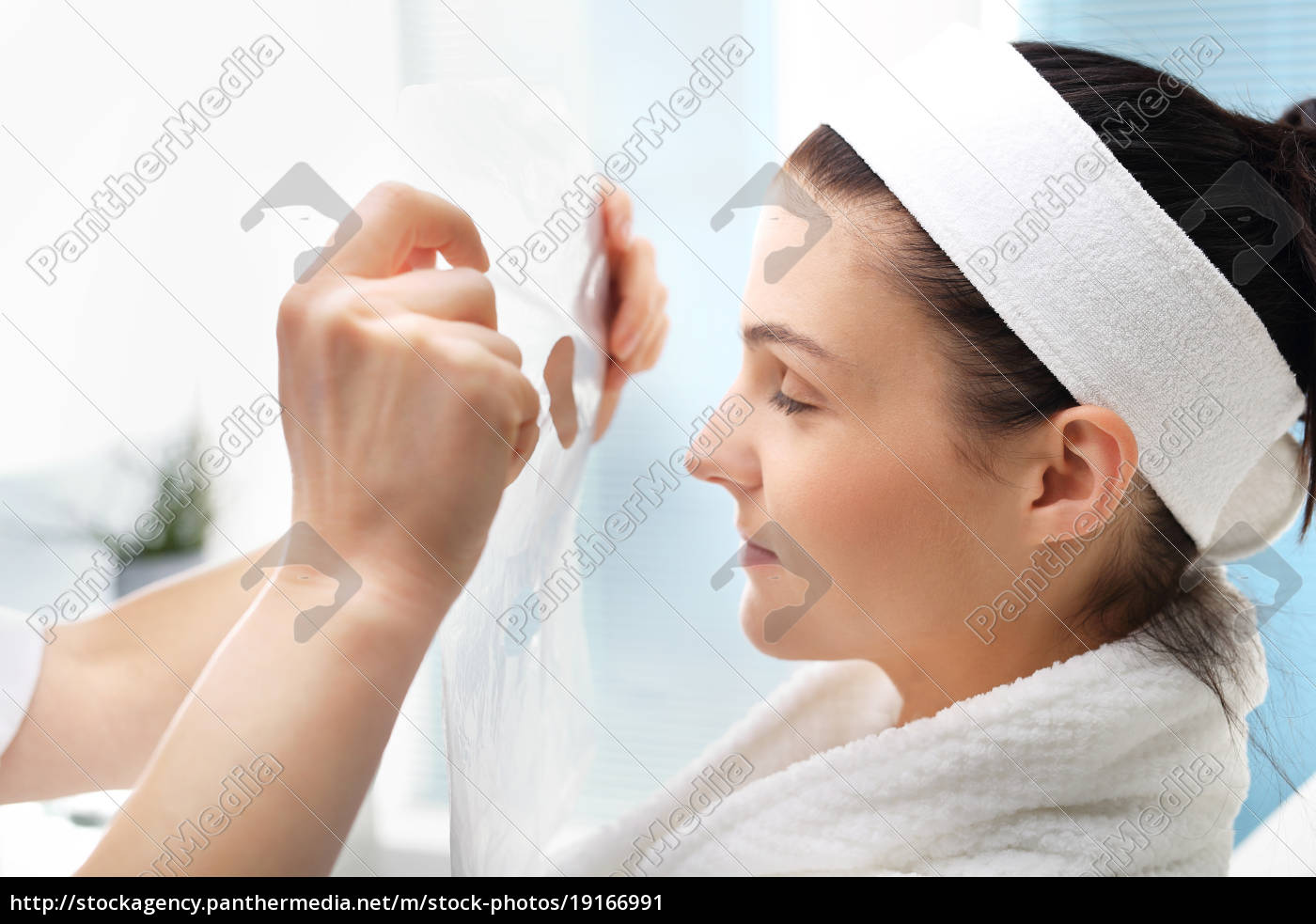 a, woman's, face, during, a, treatment - 19166991