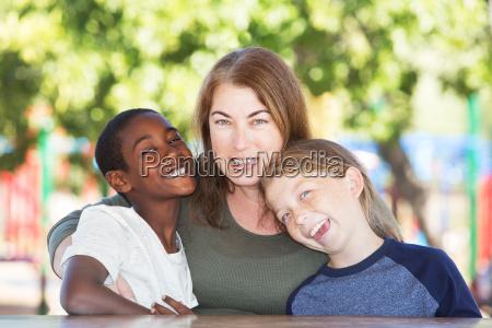joyful single parent with sons at